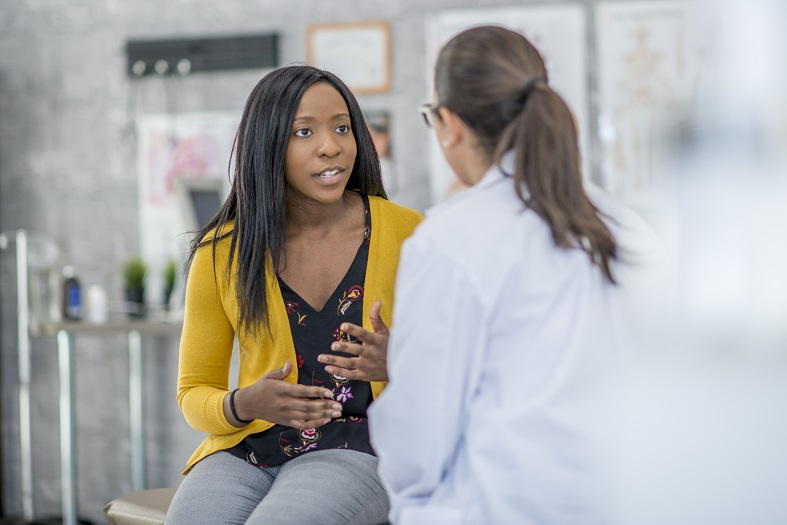Woman in a consultation with health care provider