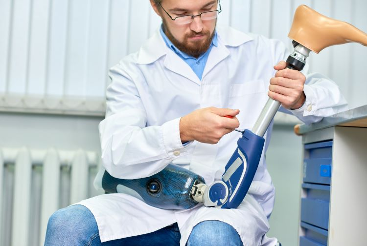 Scientist holding artificial leg