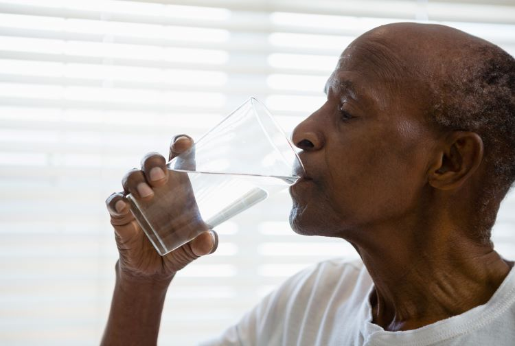 Black man drinking water