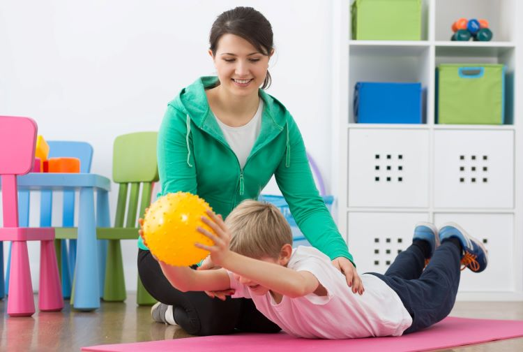 Child doing exercises with a physical therapist
