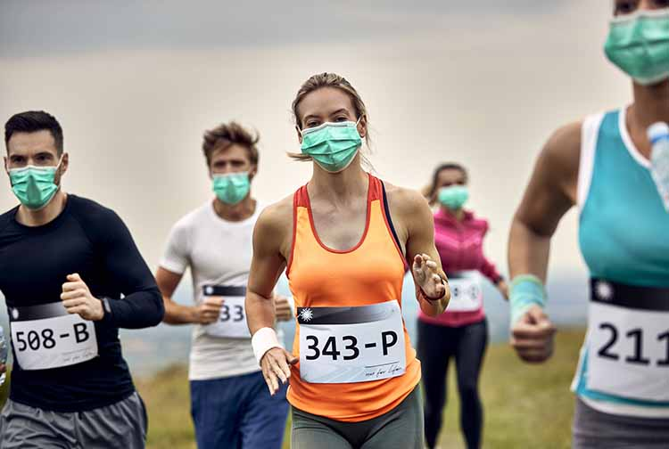 Runners in a race wearing masks