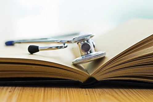 Stethoscope on pages of open book