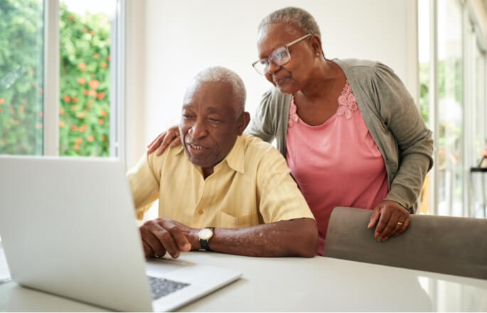Older couple looking at a laptop together
